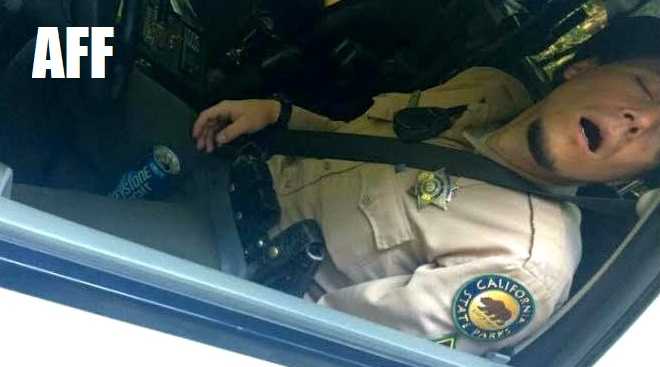 BUSTED! OFFICER PASSED OUT IN PATROL CAR WITH BEER BETWEEN HIS LEGS!