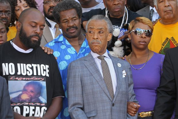 INSANITY! MICHAEL BROWN'S MOM BEATS FAMILY WITH METAL PIPE!