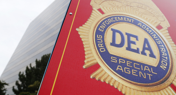 A sign with a DEA badge marks the entrance to the U.S. Drug Enforcement Administration Museum in Arlington, Virginia. (REUTERS)