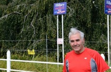 """Andy Sabin has resorted to protecting his """"Hillary for Prison"""" signs with an electric fence. Photo: Doug Kuntz"""