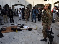 Pakistani security personnel stand alongside the body of an attacker in a Peshawar mosque - AFP photo